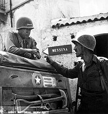 2014.09.16_Patton_speaking_with_Lt._Col._Lyle_Bernard,_at_Brolo,_circa_1943